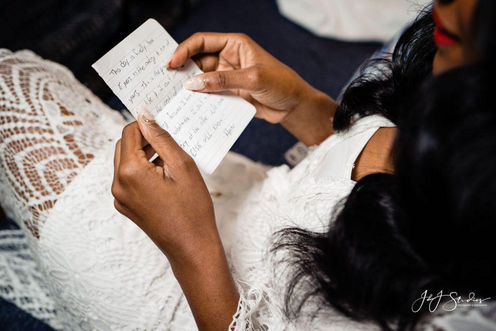 bride writes wedding vows