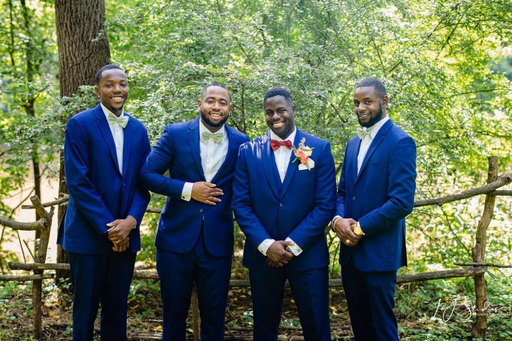 Black men in wedding tuxs