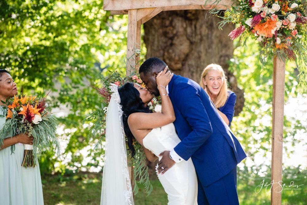 Black couple kiss at wedding