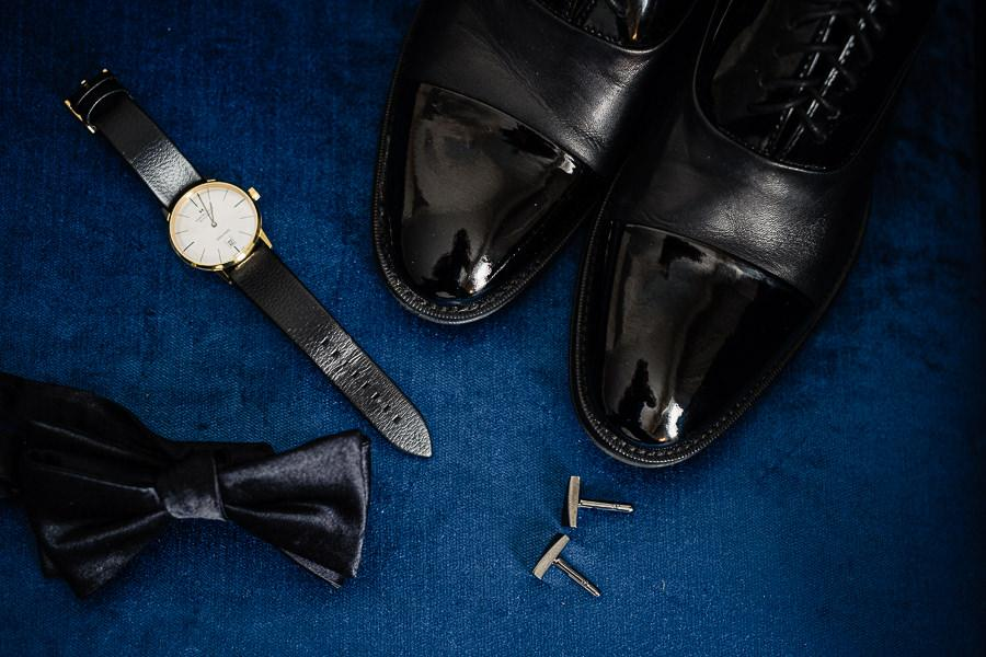 groom details: bow-tie, watch and black wing-tipped shoes