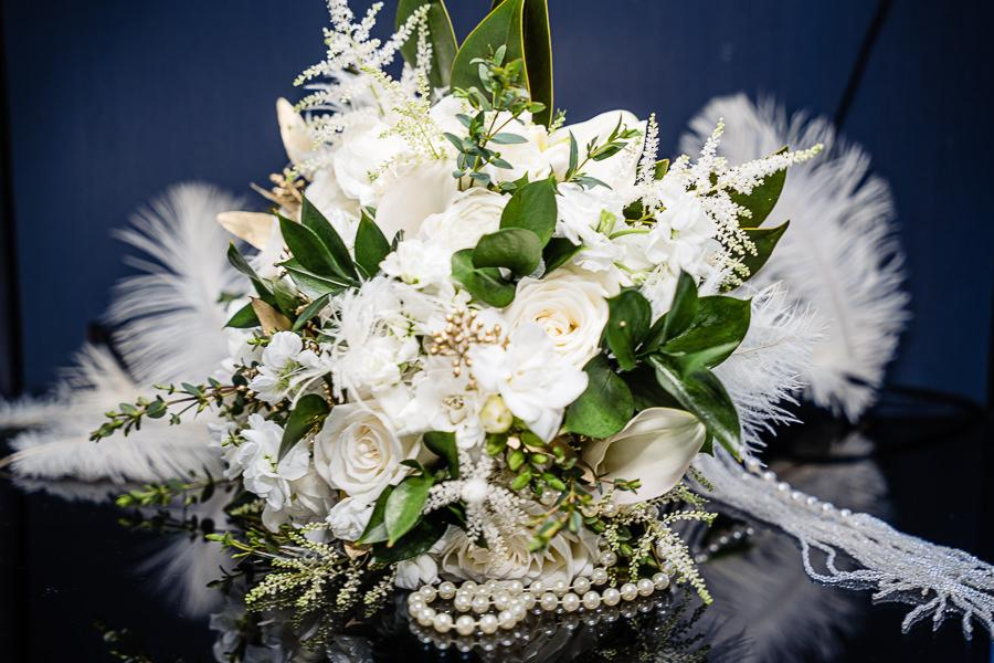 feather and white floral bridal bouquet