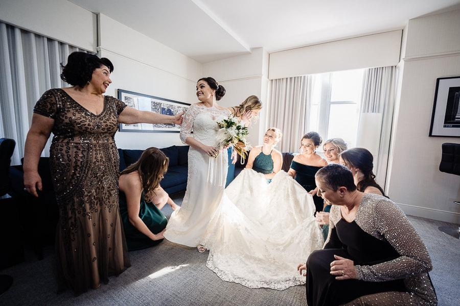 bride and bridal party get ready