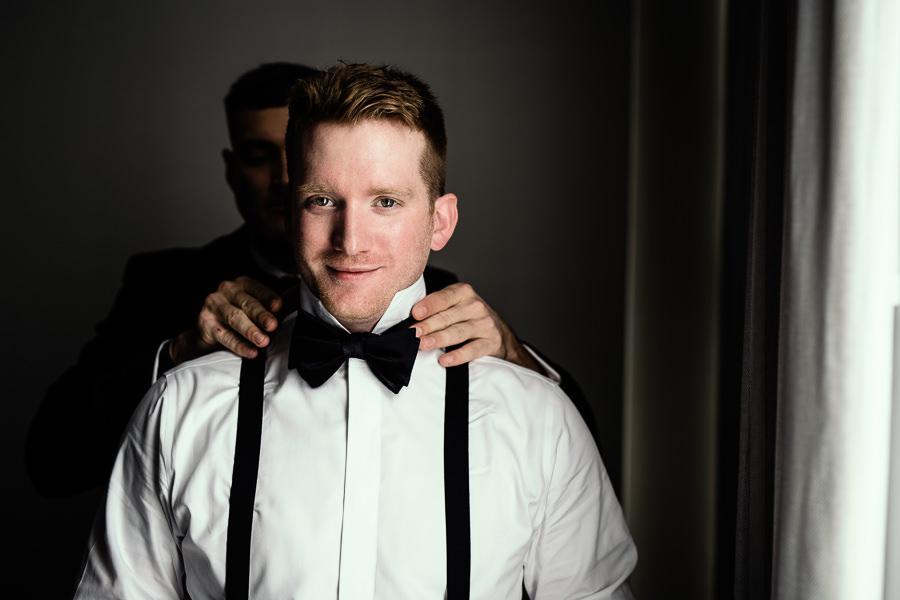 groom getting ready for wedding