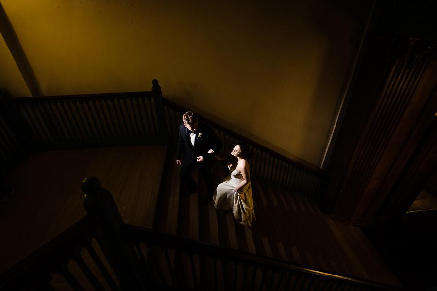 bride and groom on grand staircase