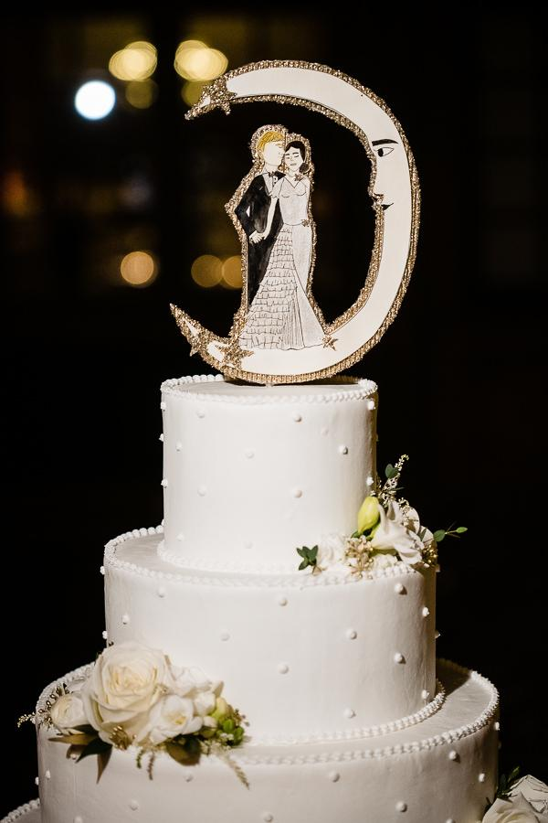white 4-tiered wedding cake with crescent moon topper