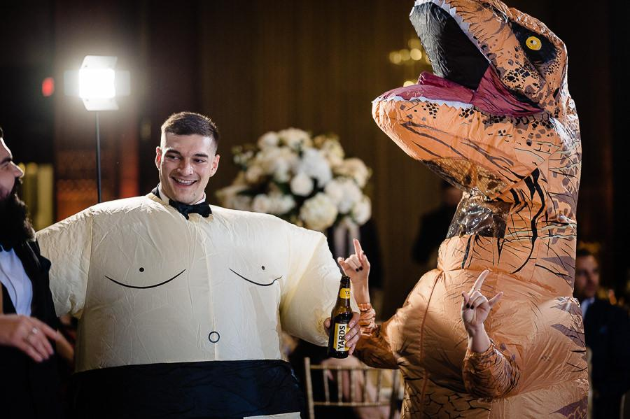 wedding guest and inflatable t-rex