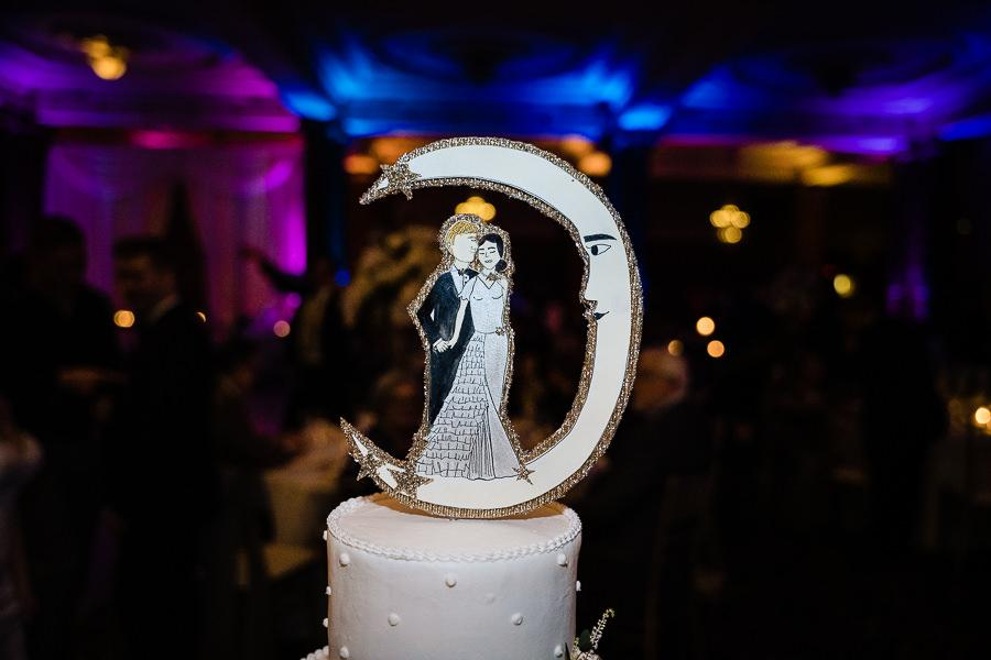 bride and groom crescent moon wedding cake topper