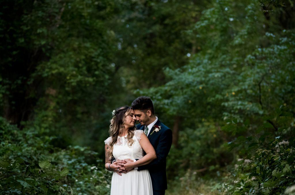 Philadelphia wedding photographers, Stephanie Johnson Photography, bride and groom embrace in nature