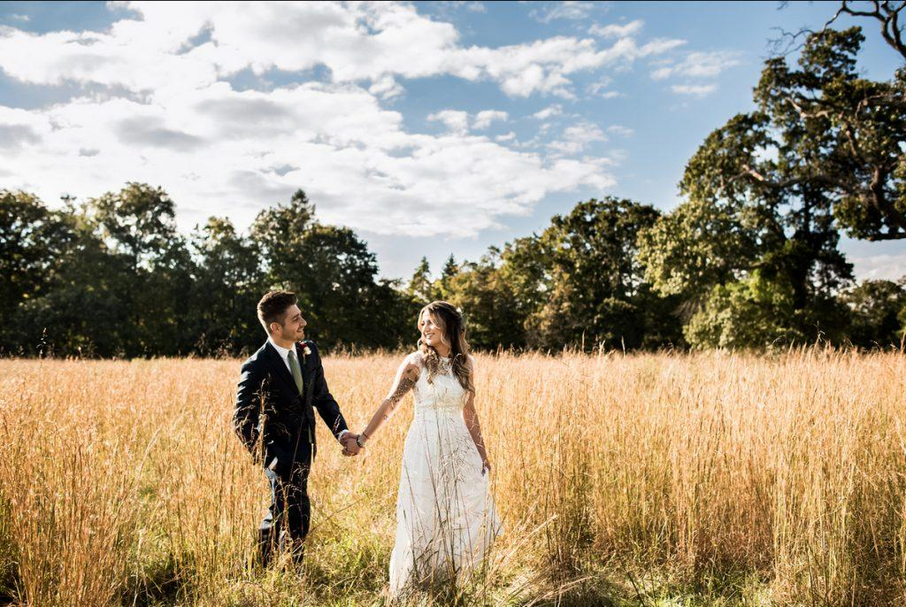 Philadelphia wedding photographers, Stephanie Johnson Photography, bride and groom walk in field