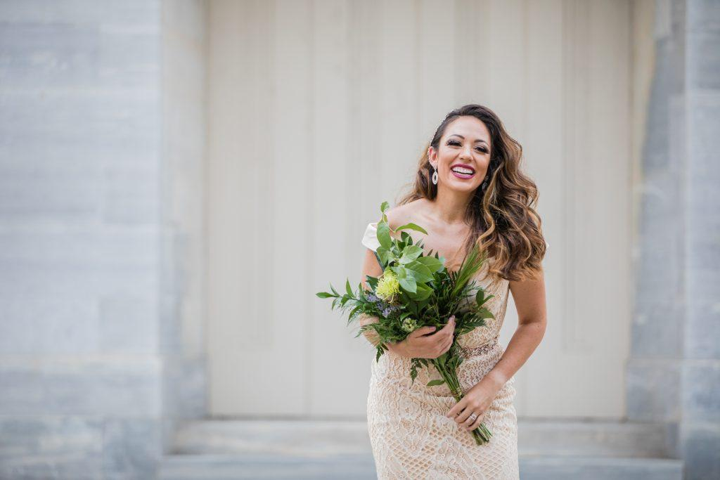 Philadelphia wedding photographers, the philatographer, bride laughing with flower bouquet