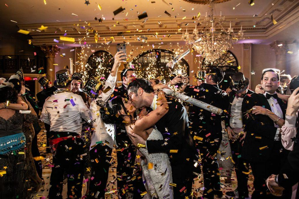 Philadelphia wedding photographers, Inna Ovsepian Photography, bride and groom kiss on new years eve