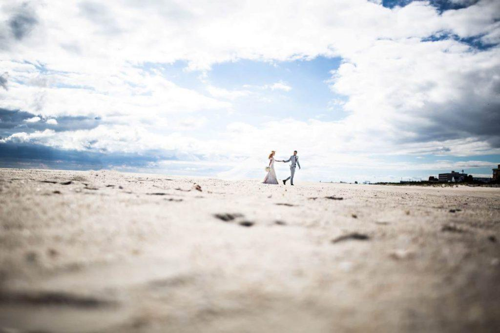 Philadelphia wedding photographers, Inna Ovsepian Photography, bride and groom walk on beach