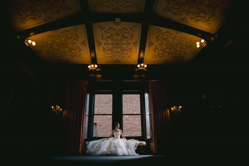 Philadelphia wedding photographers, Iryna Shostak Photography, bride portrait in window